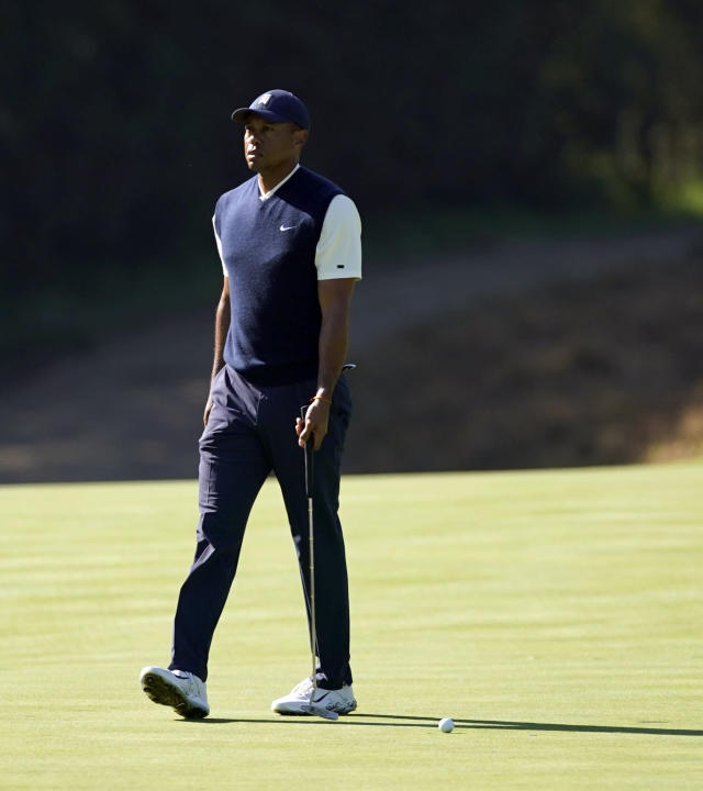 Tiger Woods reacts after missing a putt for bogey on the 13th hole during the third round of the Genesis Invitational golf tournament at Riviera Country Club, Saturday, Feb. 15, 2020, in the Pacific Palisades area of Los Angeles. (AP Photo/Ryan Kang)
