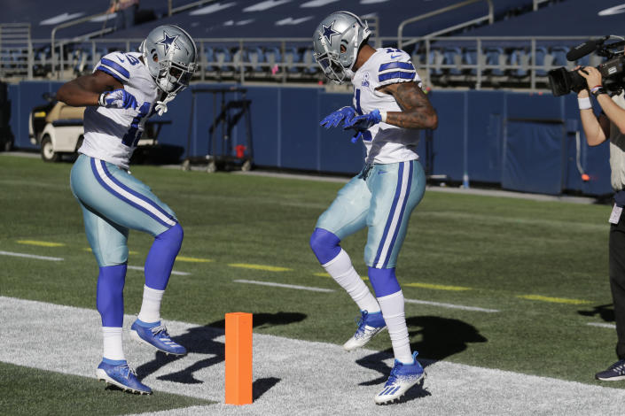 Dallas Cowboys wide receiver Ced Wilson, right, celebrates with wide receiver Michael Gallup, left, after Wilson scored a touchdown during the second half of an NFL football game against the Seattle Seahawks, Sunday, Sept. 27, 2020, in Seattle. (AP Photo/John Froschauer)