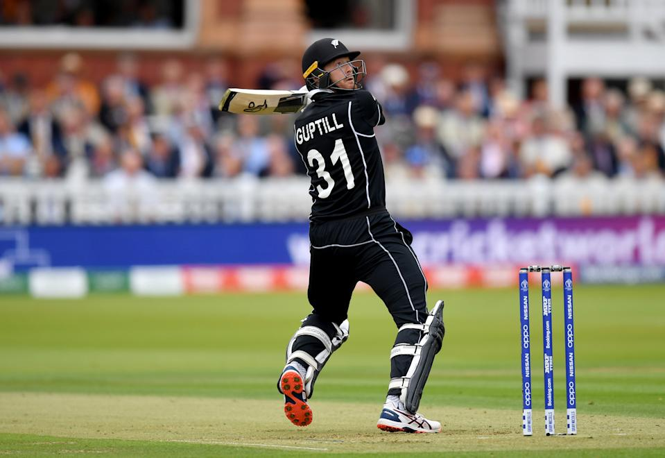 Martin Guptill smashes a six in the opening overs of the match. (Photo by Mike Hewitt/Getty Images)