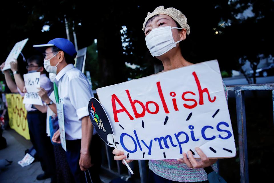 Anti-Olympic protesters gather outside Japanese prime minister Yoshihide  Suga's office (REUTERS)