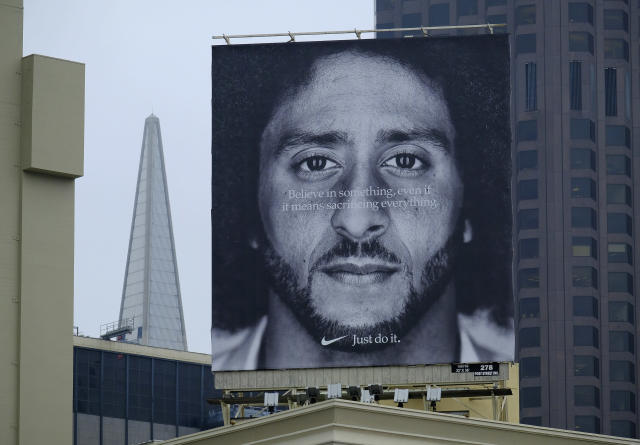 A large billboard stands on top of a Nike store showing former San Francisco 49ers quarterback Colin Kaepernick at Union Square, Wednesday, Sept. 5, 2018, in San Francisco. An endorsement deal between Nike and Colin Kaepernick prompted a flood of debate Tuesday as sports fans reacted to the apparel giant backing an athlete known mainly for starting a wave of protests among NFL players of police brutality, racial inequality and other social issues. (AP)