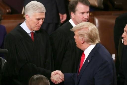 US President Donald Trump (R) appointed Neil Gorsuch (L) to the US Supreme Court as a reliably conservative voice