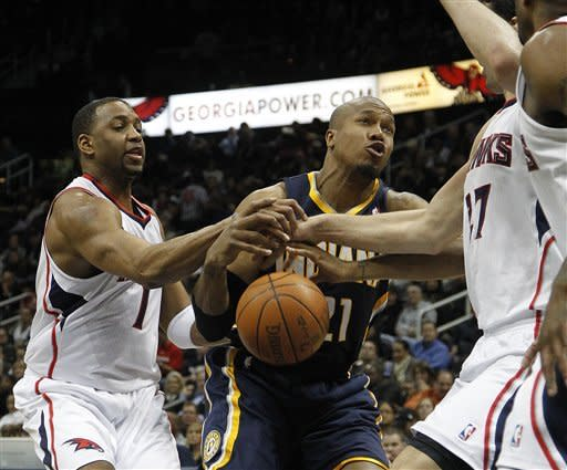 Indiana Pacers forward David West (21) loses control of the ball as he tries to get past Atlanta Hawks forward Tracy McGrady (1) in the second quarter of an NBA basketball game Wednesday, Feb. 8, 2012 in Atlanta. (AP Photo/John Bazemore)