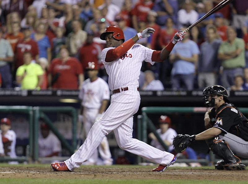 Philadelphia Phillies' John Mayberry follows through on a grand slam in the 11th inning of a baseball game against the Miami Marlins, Tuesday, June 4, 2013, in Philadelphia. The Phillies own 7-3. (AP Photo/Laurence Kesterson)