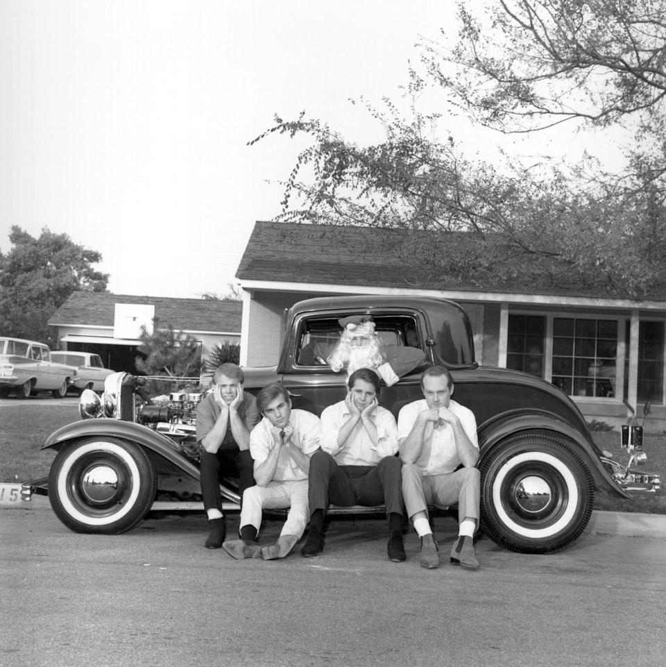 <p>The California rockers sit for a portrait in front of a vintage car driven by Santa Claus in 1963.</p>