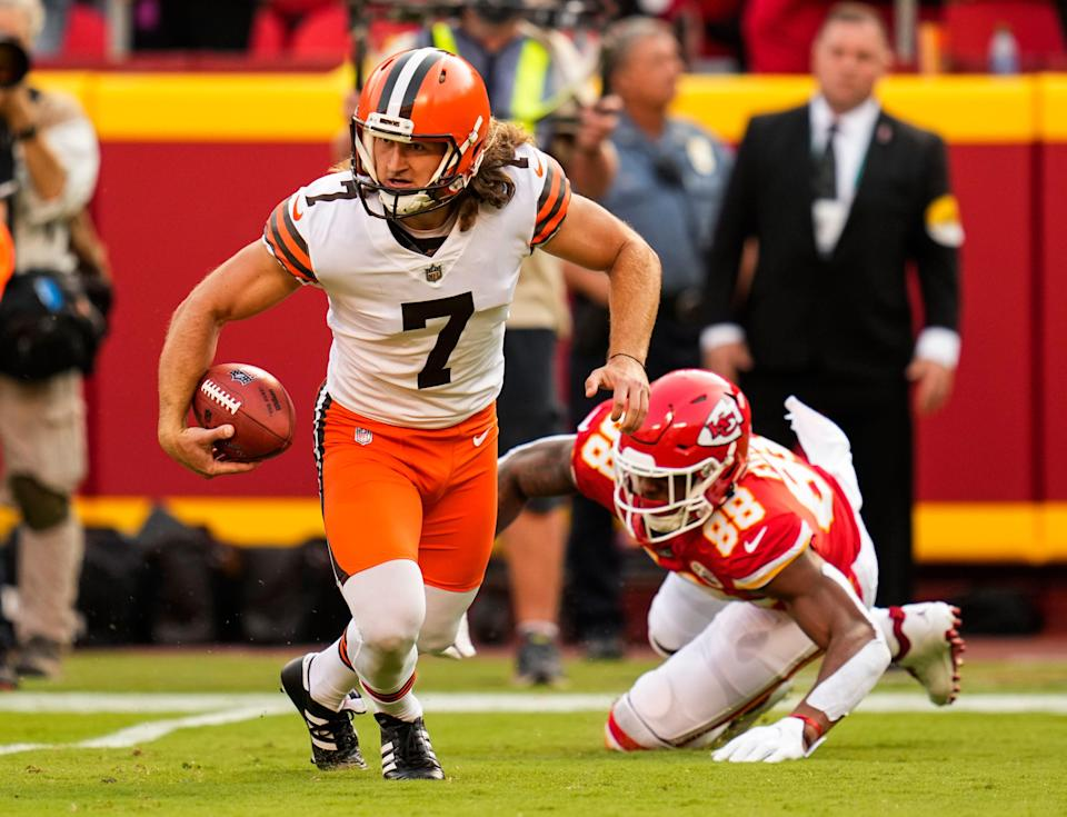 Browns punter Jamie Gillan scrambles away from Chiefs tight end Jody Fortson on Sunday.