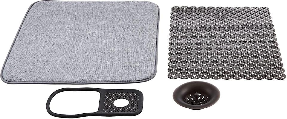 <p>The <span>Amazon Basics Sink Set Bundle </span> ($15) will give your sink the instant upgrade it deserves. It comes with a drying mat, a drain stopper, a sink liner, and a sink caddy.</p>