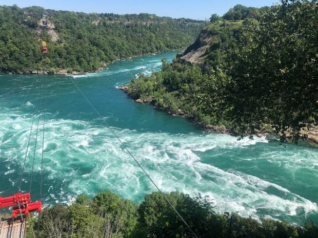 A 911 call came in around 5 p.m. about swimmers in distress near the Niagara Glen, and officers later pulled a Toronto woman from the water in critical condition. (Greg Bruce/CBC - image credit)