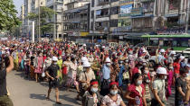 In this image from video, a crowd of protesters march in Yangon, Myanmar Saturday, Feb. 6, 2021. The military authorities in charge of Myanmar broadened a ban on social media following this week's coup, shutting access to Twitter and Instagram, while street protests continued to expand Saturday as people gathered again to show their opposition to the army takeover. (AP Photo)