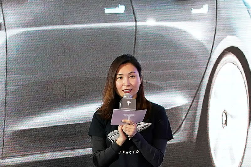 Tesla Inc's Grace Tao attends a delivery ceremony for the EV maker's China-made Model 3 cars in Shanghai