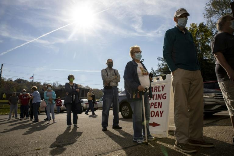 Early voters line up outside of the Vienna Community Building to cast their ballots for the November 3 election, in Vienna, West Virginia, on October 21, 2020