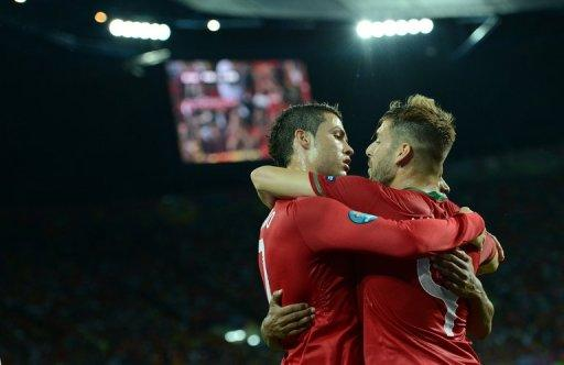 Ronaldo (right) celebrates with teammate Miguel Veloso on Sunday