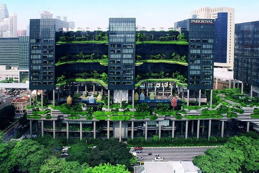 """<p>The Singapore hotel appears as if two columns of forest grow between its three buildings. In reality, it's just one single structure with the massive gardens built into the framework. (Photo: <a href=""""http://www.parkroyalhotels.com/"""">PARKROYAL Hotels</a>)</p>"""
