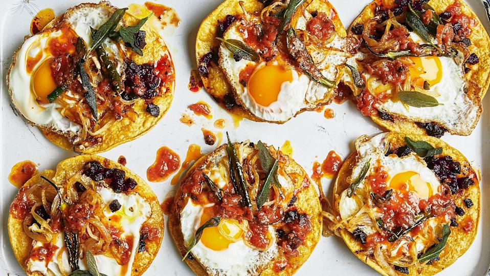 "Well-seasoned beets make a great stand-in for chorizo in these tostadas. If beets aren't your thing, any sweet root vegetable will work. <a href=""https://www.epicurious.com/recipes/food/views/beet-tostadas-with-fried-eggs?mbid=synd_yahoo_rss"" rel=""nofollow noopener"" target=""_blank"" data-ylk=""slk:See recipe."" class=""link rapid-noclick-resp"">See recipe.</a>"