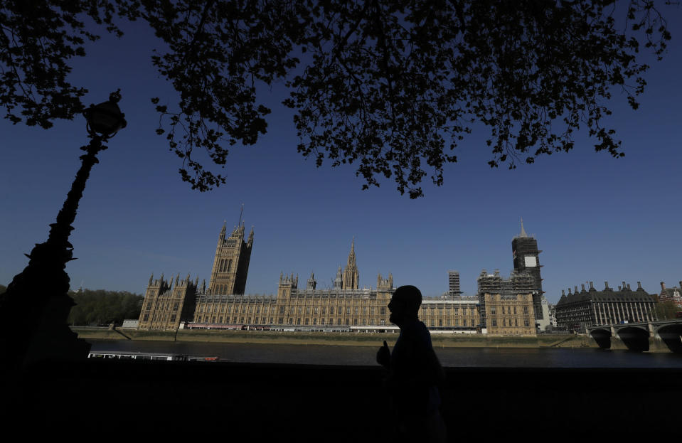 FILE - In this file photo dated Tuesday, April 21, 2020, the sun shines above Britain's Houses of Parliament in London as the country is in lockdown to help curb the spread of coronavirus. The government has decided to scrap a remote-voting system used during the coronavirus pandemic, and has summoned lawmakers back to parliament on Tuesday June 2, 2020, but many aren't happy with the arrangements. (AP Photo/Kirsty Wigglesworth, FILE)