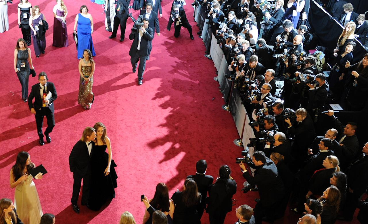 HOLLYWOOD, CA - FEBRUARY 26: Actor Brad Pitt (L) and actress Angelina Jolie arrive on the red carpet of the 84th Annual Academy Awards at the Kodak Theatre on February 26, 2012 in Hollywood, California.  (Photo by Michael Buckner/Getty Images)