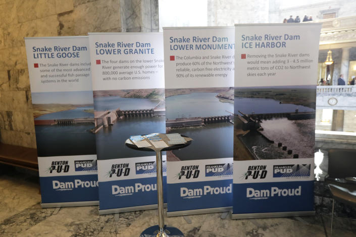 In this Feb. 12, 2020, photo, informational signs promoting dams on the Snake River are displayed during a lobby day at the Capitol in Olympia, Wash. A federal report released Friday, Feb. 28, rejected the idea of removing four hydroelectric dams on a major Pacific Northwest river in a last-ditch effort to save threatened and endangered salmon. The report says breaching the dams would destabilize the power grid, increase greenhouse emissions and raise the risk of power outages. (AP Photo/Ted S. Warren)