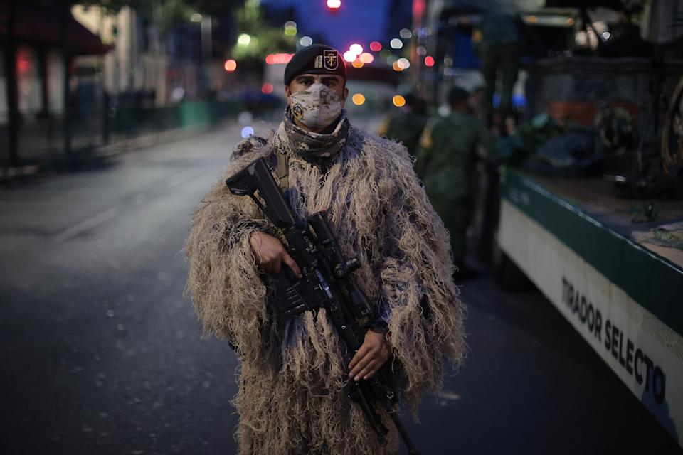 VARIOUS CITIES, MEXICO - SEPTEMBER 16: A Mexican soldier poses during the Independence Day military parade at Zocalo Square on September 16, 2020 in Various Cities, Mexico. This year El Zocalo remains closed for general public due to coronavirus restrictions. Every September 16 Mexico celebrates the beginning of the revolution uprising of 1810. (Photo by Hector Vivas/Getty Images)