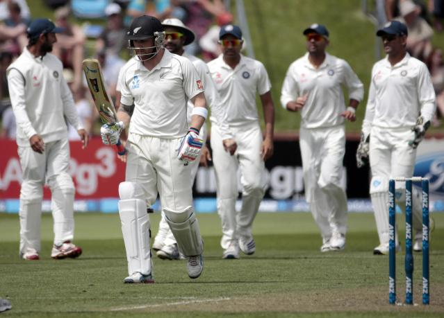 India's players celebrate the dismissal of New Zealand's Brendon McCullum (2nd L) during day one of the second international test cricket match at the Basin Reserve in Wellington, February 14, 2014. REUTERS/Anthony Phelps (NEW ZEALAND - Tags: SPORT CRICKET)