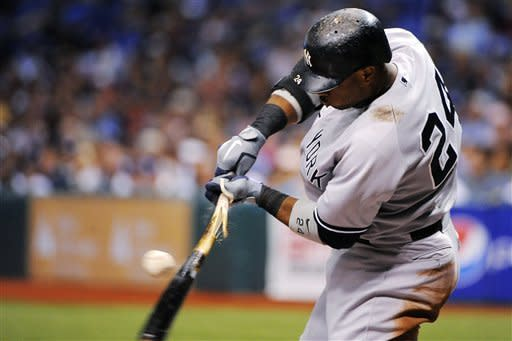New York Yankees' Robinson Cano breaks his bat as he hits a single off of Tampa Bay Rays starting pitcher Matt Moore during the sixth inning of a baseball game, Monday, July 2, 2012, in St. Petersburg, Fla. (AP Photo/Brian Blanco)