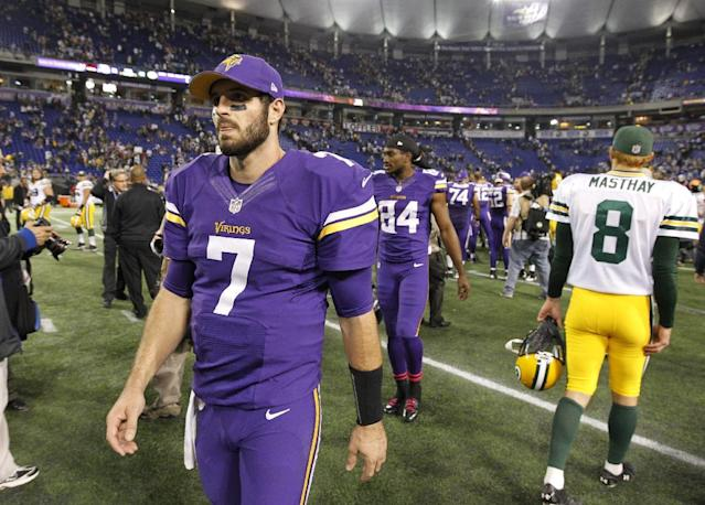 Minnesota Vikings quarterback Christian Ponder (7) walks off the field after an NFL football game against the Green Bay Packers, Sunday, Oct. 27, 2013, in Minneapolis. The Packers won 44-31. (AP Photo/Ann Heisenfelt)