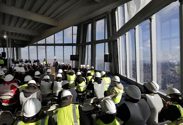 Port Authority Chairman David Samson, at podium center left, addresses a news conference in observation deck on the 100th floor of the One World Trade Center building, under construction in New York, Tuesday, April 2, 2013. The observation deck will occupy the tower's 100th through 102nd floors. Elevators will whisk visitors to the top in just one minute but the experience of visiting the attraction will take an hour. (AP Photo/Richard Drew)