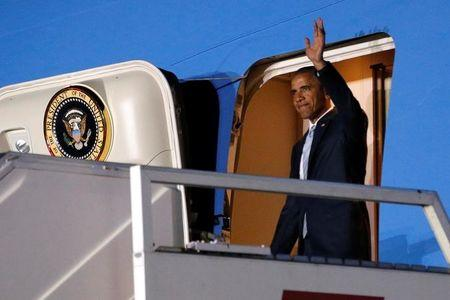 Obama arrives aboard Air Force One ahead of a NATO Summit, at Chopin Airport in Warsaw, Poland