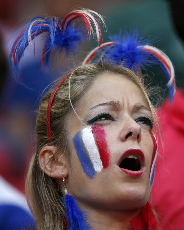 A France supporter waits for the start of their 2014 World Cup round of 16 game against Nigeria at the Brasilia national stadium in Brasilia June 30, 2014. REUTERS/Jorge Silva (BRAZIL - Tags: SOCCER SPORT WORLD CUP)