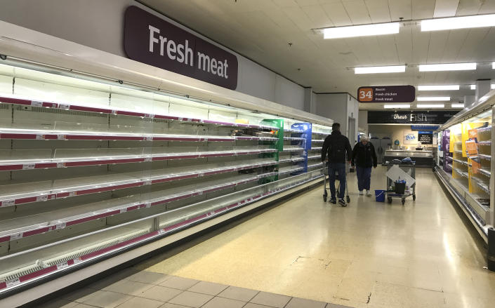 Empty shelves in a supermarket in London, Thursday, March 19, 2020. For some people the new coronavirus causes mild or moderate symptoms, such as fever and cough, but for some, especially older adults and people with existing health problems, it can cause more severe illness, including pneumonia. (AP Photo/Kirsty Wigglesworth)