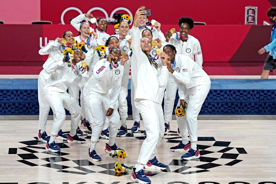 The U.S. women's basketball team celebrates winning the gold medal at the Tokyo Olympics.