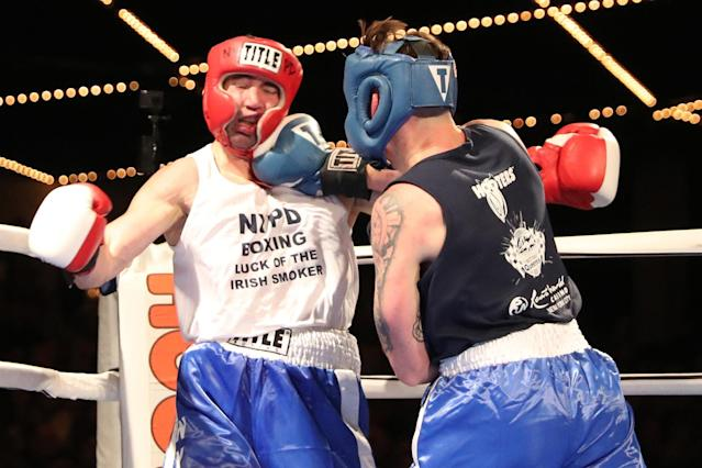 <p>Sal Tramontana takes one in the jaw from opponent Nick Salvador during the NYPD Boxing Championships at the Theater at Madison Square Garden on June 8, 2017. (Photo: Gordon Donovan/Yahoo News) </p>