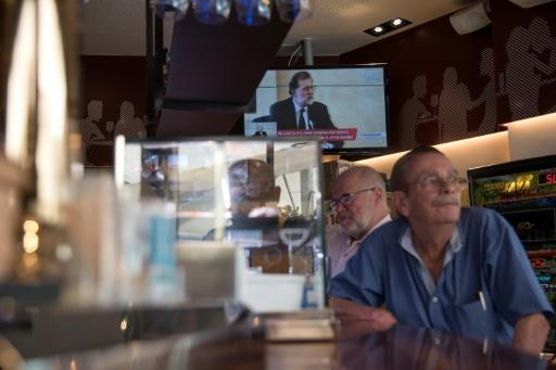 People watch Spanish Prime Minister Mariano Rajoy declaring as a witness in a major graft trial involving members of his conservative Popular Party at a bar in Barcelona in July 2017