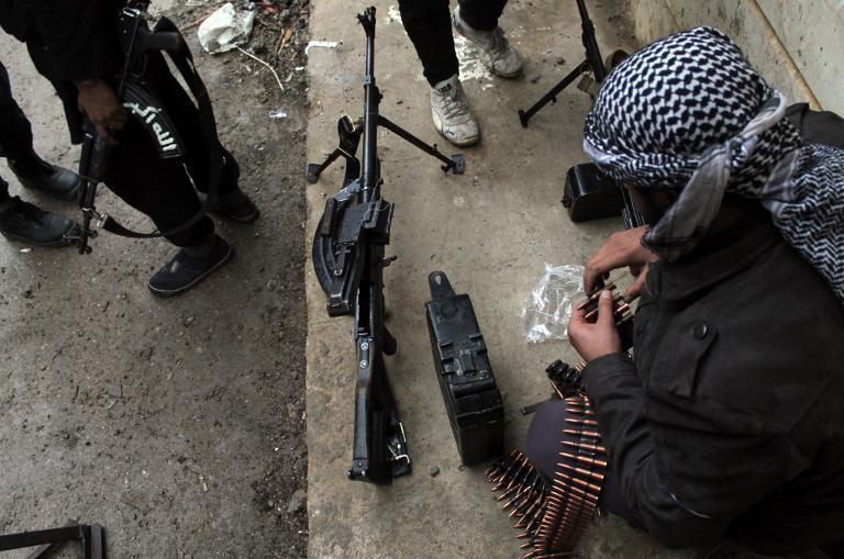 A rebel fighter checks his ammunition in the northeastern Syrian city of Deir Ezzor on December 31, 2013