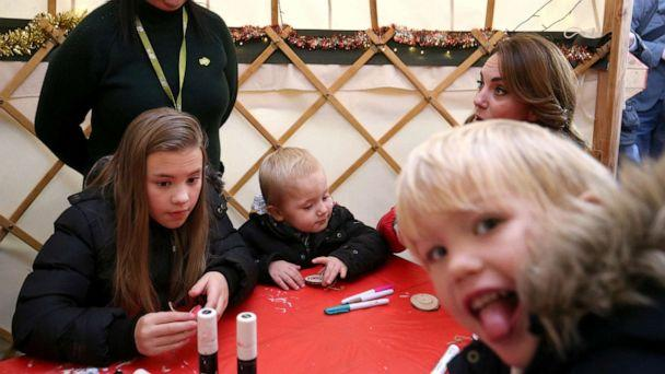 PHOTO: Catherine, Duchess of Cambridge, takes part in Christmas activities with families and children who are supported by the Family Action charity, during a visit to the Peterley Manor Farm in Buckinghamshire, Britain, Dec. 4, 2019. (Jonathan Brady/PA Wire/Pool via Reuters)