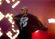 "FILE- DMX performs during the BET Hip Hop Awards in Atlanta on Oct. 1, 2011. The family of rapper DMX says he has died at age 50 after a career in which he delivered iconic hip-hop songs such as ""Ruff Ryders' Anthem."" A statement from the family says the Grammy-nominated rapper died at a hospital in White Plains, New York, ""with his family by his side after being placed on life support for the past few days. He was rushed to a New York hospital from his home April 2. (AP Photo/David Goldman, File)"