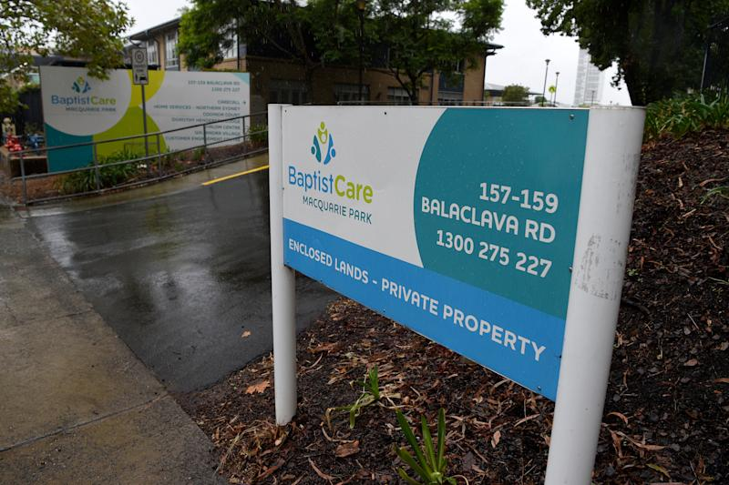 Signage at the entrance of the BaptistCare Dorothy Henderson Lodge Aged Care Centre in Sydney. Source: AAP