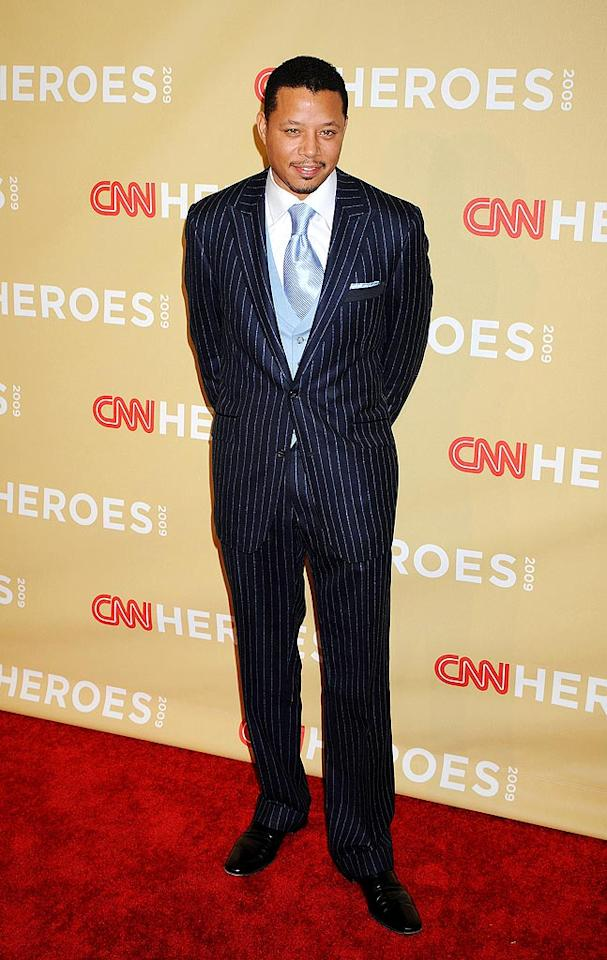 "Terrence Howard stood out in a pinstripe suit, which he paired with a baby blue vest and tie. Hot or not? Jeffrey Mayer/<a href=""http://www.wireimage.com"" target=""new"">WireImage.com</a> - November 21, 2009"