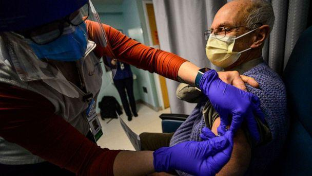 PHOTO: A registered nurse with Grace Cottage Family Health & Hospital, in Townshend, Vt., administers a COVID-19 vaccine to Timothy Shafer, clinical physician and president of the medical staff, on Dec. 16, 2020. (The Brattleboro Reformer via AP, FILE)