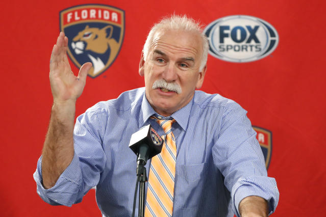 Florida Panthers head coach and former Chicago Blackhawks coach, Joel Quenneville, responds to a question during his first visit back to Chicago as a head coach before an NHL hockey game between the Blackhawks and Panthers Tuesday, Jan. 21, 2020, in Chicago. (AP Photo/Charles Rex Arbogast)