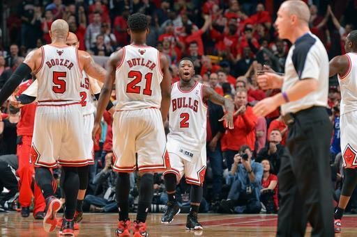 CHICAGO, IL - APRIL 27: (L-R) Carlos Boozer #5, Jimmy Butler #21, and Nate Robinson #2 of the Chicago Bulls congratulate each other on their win against the Brooklyn Nets in Game Four of the Eastern Conference Quarterfinals during the 2013 NBA Playoffs on April 27, 2013 at United Center in Chicago, Illinois. (Photo by Jesse D. Garrabrant/NBAE via Getty Images)