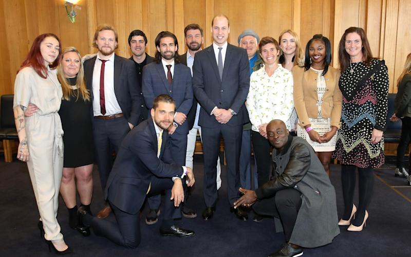 Duke of Cambridge poses with runners from BBC documentary 'Mind over Marathon'
