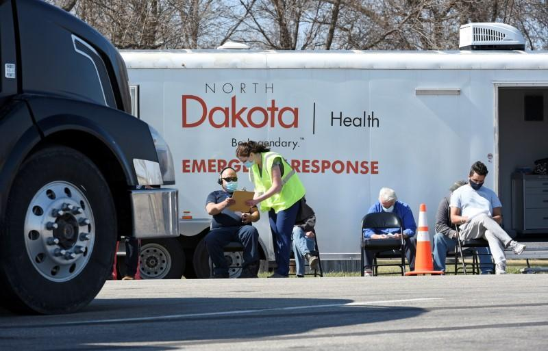 FILE PHOTO: Manitoba-based truckers transporting goods to and from the U.S. get vaccinated against coronavirus disease (COVID-19), North Dakota