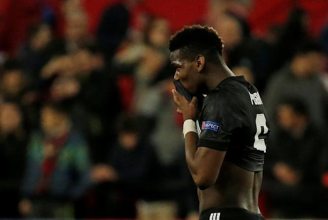 Soccer Football - Champions League Round of 16 First Leg - Sevilla vs Manchester United - Ramon Sanchez Pizjuan, Seville, Spain - February 21, 2018 Manchester United's Paul Pogba looks dejected after the match REUTERS/Jon Nazca
