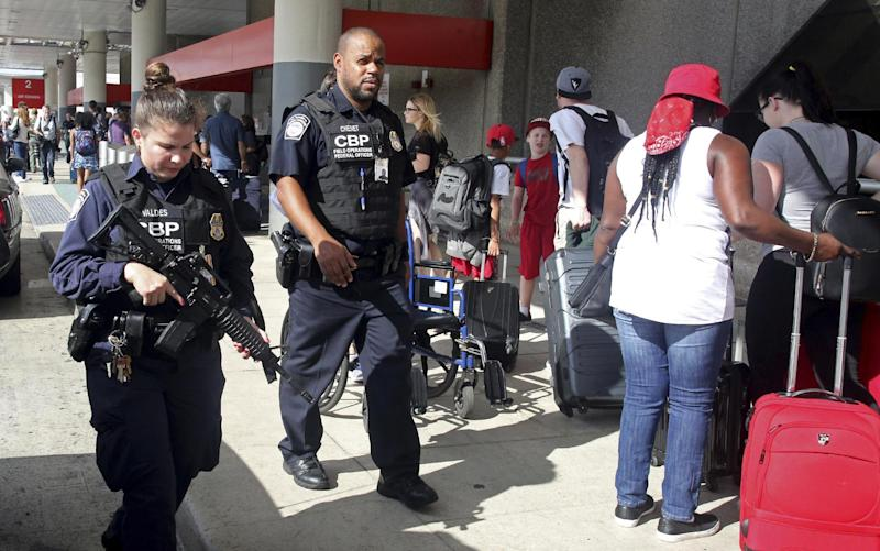 A heavy police presence was at the Ft. Lauderdale-Hollywood International Airport after it re-opened Saturday, Jan. 7, 2017. Investigators continued their work downstairs in the baggage area of terminal 2 the day after a shooting. (Mike Stocker /South Florida Sun-Sentinel via AP)