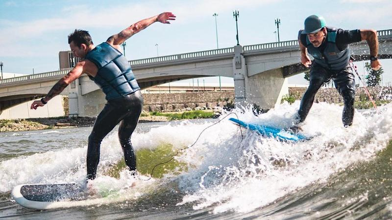 Surf Dayton cofounder Jake Brown and Shannon Thomas riding river waves