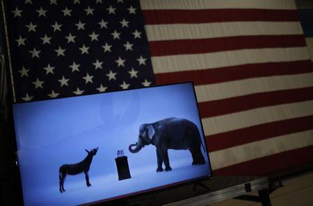 The mascots of the Democratic and Republican parties are seen on a video screen at Democratic U.S. presidential candidate Hillary Clinton's campaign rally in Cleveland