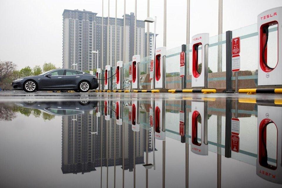 A Tesla electric car at a charging point in Beijing. Photo: Reuters