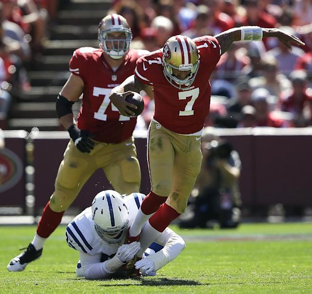 San Francisco 49ers quarterback Colin Kaepernick (7) is tripped up by Indianapolis Colts linebacker Bjoern Werner during the second quarter of an NFL football game in San Francisco, Sunday, Sept. 22, 2013. (AP Photo/Aaron Kehoe)