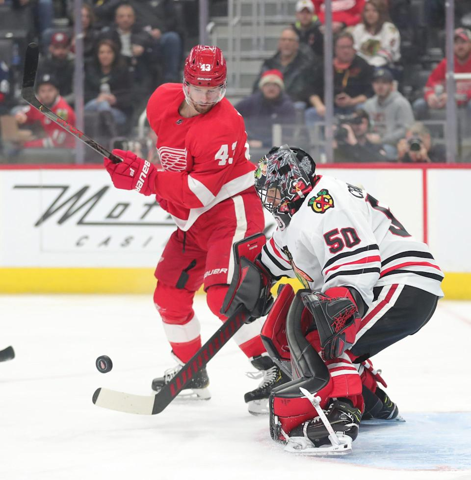 Wings left wing Darren Helm takes a shot against Blackhawks goaltender Corey Crawford on March 6, 2020 at Little Caesars Arena.