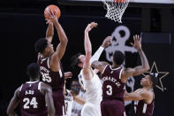 Mississippi State forward Tolu Smith (35) grabs a rebound away from Vanderbilt forward Quentin Millora-Brown (42) in the second half of an NCAA college basketball game Saturday, Jan. 9, 2021, in Nashville, Tenn. (AP Photo/Mark Humphrey)